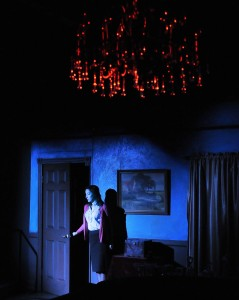 Stella Meredith, played by Jessica Mullin, explores the house at Cliff End. Photo by Alan Merrigan Photography.