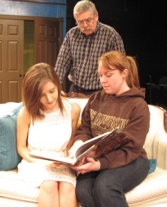 "Jessica Mullin, Mike Hanrahan, and Sabrina Foley rehearse for ""The Univited,"" opening at Redlands Footlighters November 7."