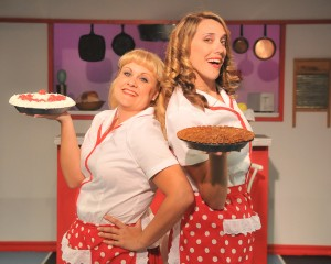 """The """"Dinettes"""" (Mia Mercado and Sandra Rice.) serve up pie at the Double Cupp Diner. Photo by Alan Merrigan."""