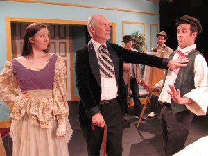 "Emily Minor, Bill Becker, and Mike Detrow rehearse for ""Is He Dead?"", opening at Redlands Footlighters March 6."